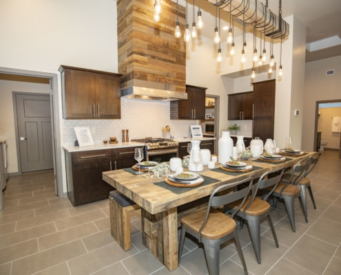 kitchen, kitchen table, reclaimed wood, hanging lights, luxury homes, arista development